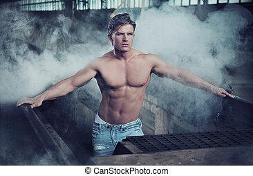 Handsome bodybuilder wearing jeans