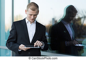 Handsome businessman with a tablet
