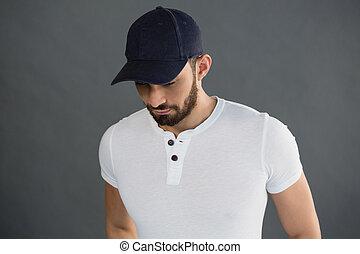 Handsome man posing against grey background