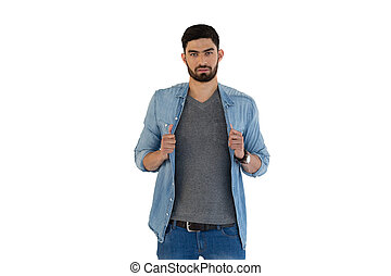 Handsome man posing against white background
