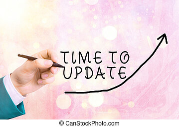 Handwriting text writing Time To Update. Concept meaning System software update for enhancement or compatibility digital arrowhead curve rising upward denoting growth development concept.