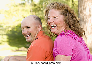 Happy Attractive Couple Laughing in Park
