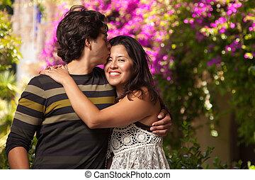 Happy Attractive Hispanic Couple At The Park