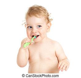 Happy baby child brushing teeth