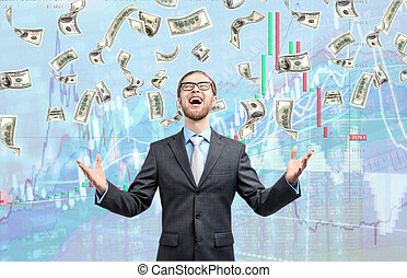 businessman trader winner, in cash rain of dollars notes