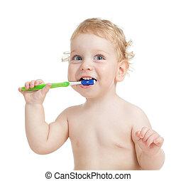 Happy child brushing teeth isolated on white