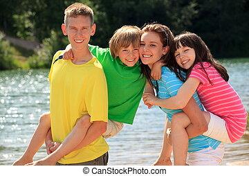 Happy children by lake