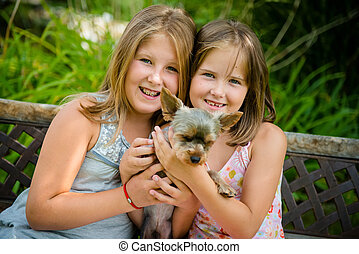Happy children with their pet