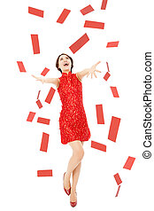 happy chinese new year. young woman trying to catch red envelope