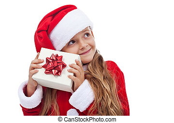 Happy christmas girl checking present
