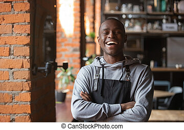 Happy confident african waiter small business owner portrait