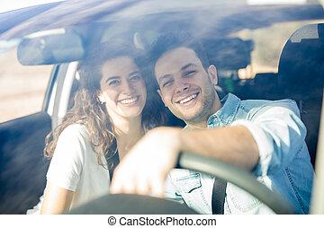 Happy couple having fun on road trip