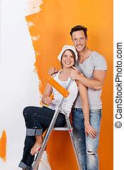 Happy couple redecorating