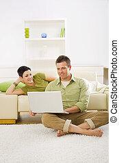 Happy couple using computer