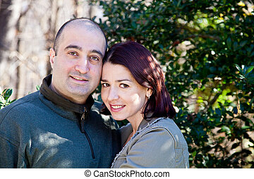 Happy Couple Wife Hugging Her Husband