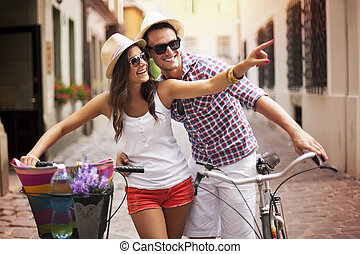 Happy couple with bikes in the city
