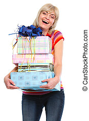 Happy elderly woman with stack of present boxes