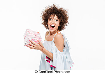 Happy excited woman holding a present box