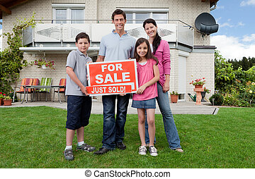 Happy family buying new house