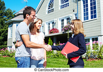 Happy family with agent realtor near new house.