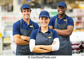 female hardware store worker and team