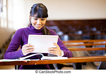 indian college student using tablet computer