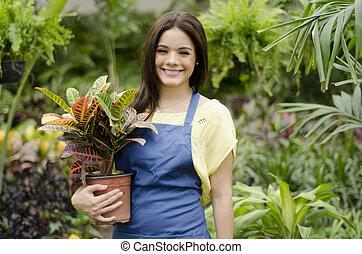Happy gardener greeting customers