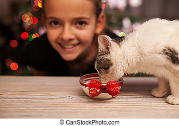 Happy girl with her rescued kitten at christmas time