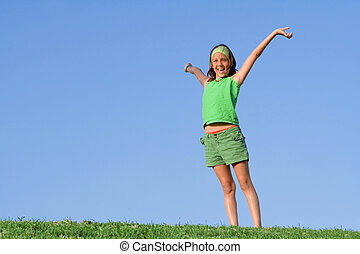 happy healthy kid outdoors in summer arms raised