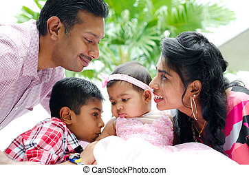 Happy Indian family with two children