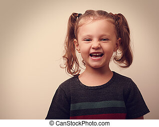 Happy laughing kid girl. Vintage closeup portrait