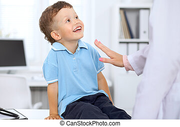 Happy little boy after health exam at doctor's office