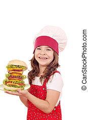 happy little girl cook with big hamburger