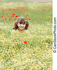 happy little girl on spring meadow