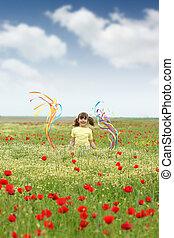 happy little girl on wildflowers meadow