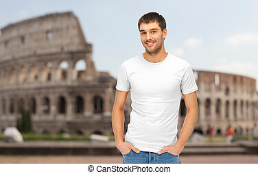 happy man in blank white t-shirt over coliseum