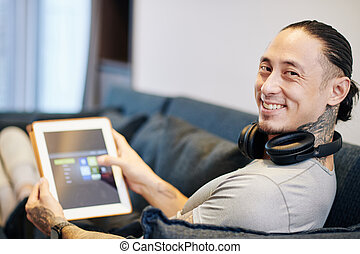 Happy man with digital tablet