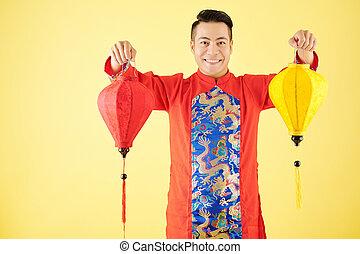 Happy man with silk lanterns