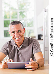 Happy man with tablet