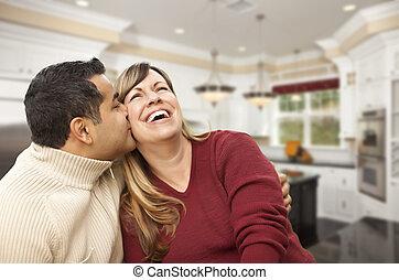 Mixed Race Couple Kissing Inside Beautiful Custom Kitchen
