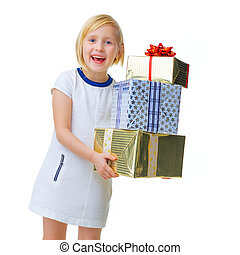 happy modern girl on white showing pile of Christmas gifts