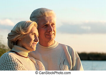 Beautiful happy old couple resting together outdoors