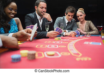 Happy people playing poker