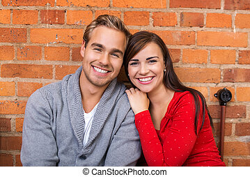 Happy Pretty Young Couple Looking at Camera