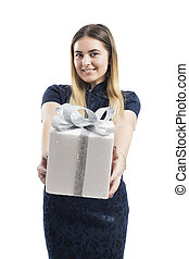 Happy pretty young woman holding gift box over white background.