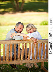 Happy retired couple sitting on the