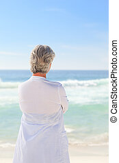 Happy retired woman on the beach