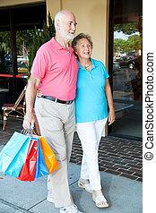 Happy Senior Couple Goes Shopping
