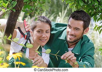 happy senior man and woman gardeners