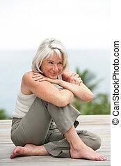 Happy senior woman outdoors